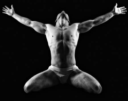 ManSkin17382492-silhouette-of-young-athlete-bodybuilder-man-on-black-