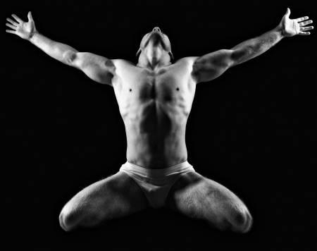 ManSkin17382492-silhouette-of-young-athlete-bodybuilder-man-on-black-